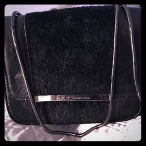 BCBG faux fur and leather crossbody bag in black